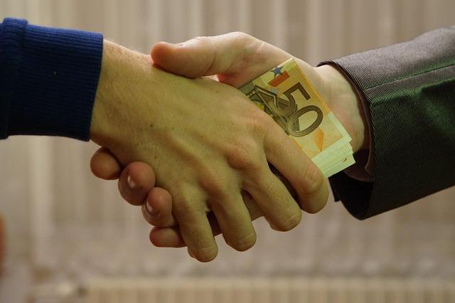 předání úplatků
